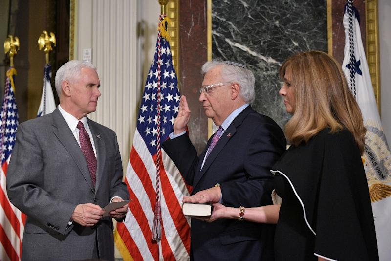 US Vice President Mike Pence administers the swearing-in ceremony for David Friedman as the US ambassador to Israel, as his wife Tammy Sand stands by, in Washington, DC, on March 29, 2017