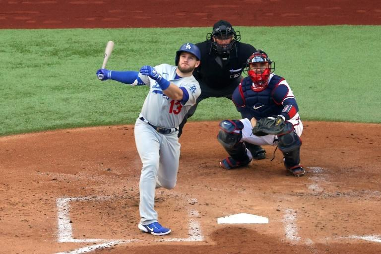Los Angeles Dodgers slugger Max Muncy hits a home run to cap a record-setting 11-run first inning in his team's victory over the Atlanta Braves in game three of baseball's National League Championship Series