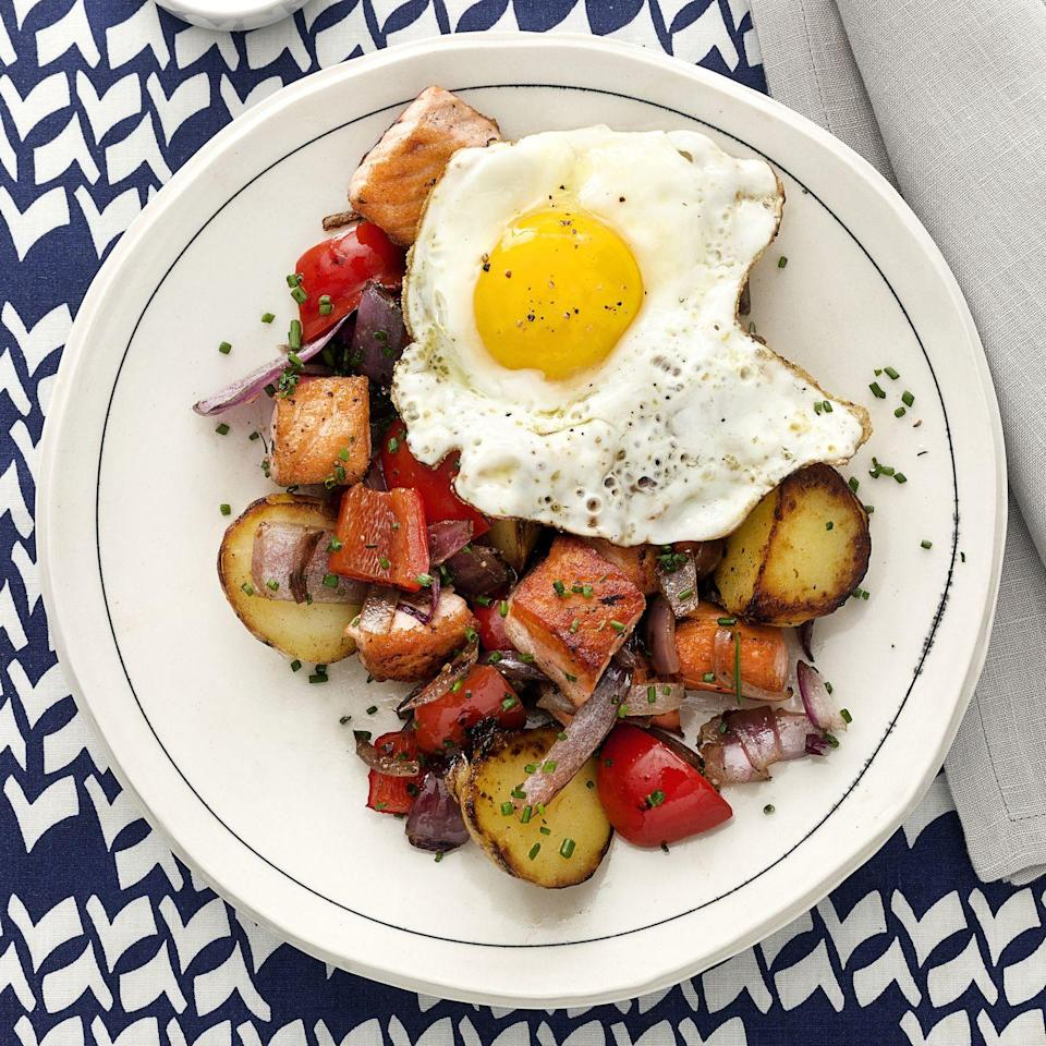 """<p>Whether it's breakfast, brunch, or dinner, roasted veggies and a sunny-side-up egg pretty much always hit the spot—especially if they're served with rich, buttery salmon. With a whopping 37 grams of protein per serving, it will keep your belly full, too.</p><p><a href=""""https://www.prevention.com/food-nutrition/recipes/a34165285/salmon-hash-sunny-side-up-eggs-recipe/"""" rel=""""nofollow noopener"""" target=""""_blank"""" data-ylk=""""slk:Get the recipe »"""" class=""""link rapid-noclick-resp""""><strong><em>Get the recipe »</em></strong></a></p>"""