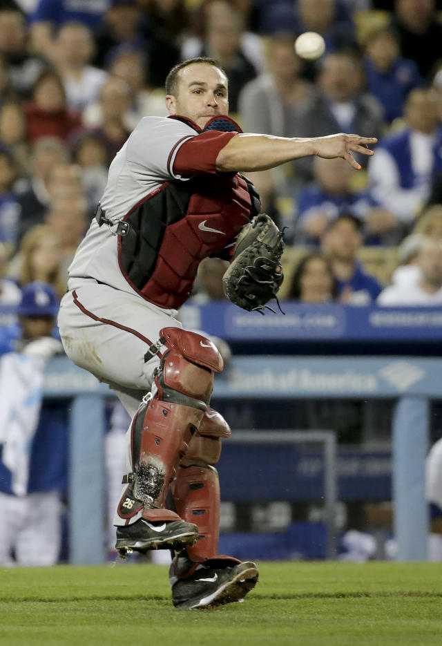 Arizona Diamondbacks catcher Miguel Montero throws Los Angeles Dodgers' Hanley Ramirez out at first during eighth inning of a baseball game in Los Angeles, Friday, April 18, 2014. (AP Photo/Chris Carlson)