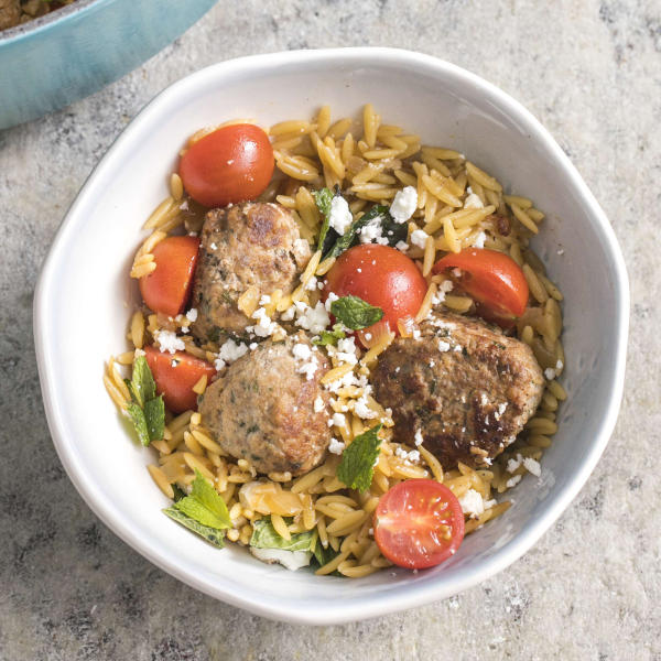"This undated photo provided by America's Test Kitchen in March 2019 shows Lamb Meatballs With Orzo in Brookline, Mass. This recipe appears in the book ""Cook It In Your Dutch Oven."" (Steve Klise/America's Test Kitchen via AP)"