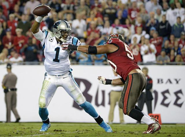 Carolina Panthers quarterback Cam Newton (1) scrambles to get away from Tampa Bay Buccaneers defensive end Daniel Te'o-Nesheim, right, during the first half of an NFL football game in Tampa, Fla., Thursday, Oct. 24, 2013. (AP Photo/Phelan M. Ebenhack)
