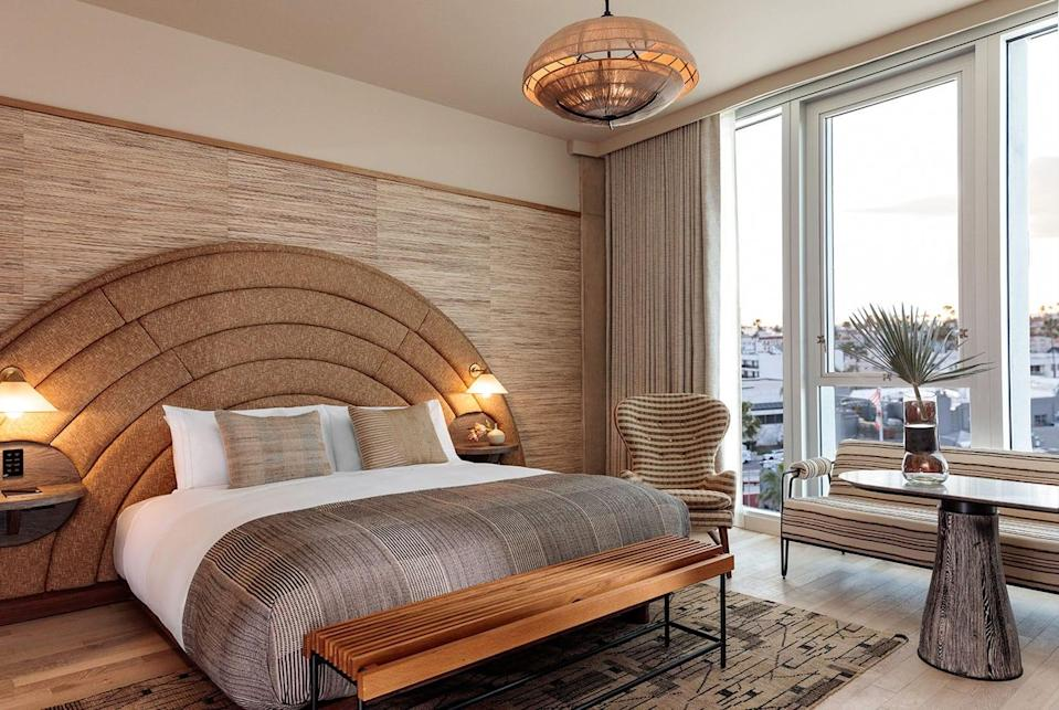 """<p><strong>Why did this hotel catch your attention?</strong> The effortlessly chic lobby lounge sets the stage for a warm welcome, (or, TBH, an impromptu Instagram shoot), with its laid back beachy aesthetic (indoor palm trees included) and a sandy, neutral color palette courtesy of famed Angeleno interior designer Kelly Wearstler.</p> <p><strong>What's the backstory?</strong> Former Viceroy Hotel Group founders Brad Korzen, Brian De Lowe, and Alex Samek have been on a tear recently, expanding the lifestyle-driven boutique hotel brand Proper to <a href=""""https://www.cntraveler.com/hotels/san-francisco/proper-hotel-san-francisco?mbid=synd_yahoo_rss"""" rel=""""nofollow noopener"""" target=""""_blank"""" data-ylk=""""slk:San Francisco"""" class=""""link rapid-noclick-resp"""">San Francisco</a>, <a href=""""https://www.cntraveler.com/hotels/austin/austin-proper-hotel?mbid=synd_yahoo_rss"""" rel=""""nofollow noopener"""" target=""""_blank"""" data-ylk=""""slk:Austin"""" class=""""link rapid-noclick-resp"""">Austin</a>, and Santa Monica, with an outpost in Downtown Los Angeles expected to open across from the <a href=""""https://www.cntraveler.com/hotels/los-angeles/the-hoxton-downtown-la?mbid=synd_yahoo_rss"""" rel=""""nofollow noopener"""" target=""""_blank"""" data-ylk=""""slk:Hoxton"""" class=""""link rapid-noclick-resp"""">Hoxton</a> this summer, and a property in <a href=""""https://www.cntraveler.com/destinations/portland-oregon?mbid=synd_yahoo_rss"""" rel=""""nofollow noopener"""" target=""""_blank"""" data-ylk=""""slk:Portland"""" class=""""link rapid-noclick-resp"""">Portland</a> coming down the pike in 2021. Their Santa Monica hotel is just blocks from the beach, and couldn't possibly be any more California cool.</p> <p><strong>Tell us all about the accommodations. Any tips on what to book?</strong> Wearstler's signature flair for mixing and matching wallpapers, textures, and eclectic pieces from around the globe is apparent in both wings of the hotel—old and new—which each have their own distinct but equally beautiful style. Beds are a dream to sleep on, and the oversize tub"""