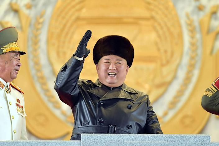 Image: Kim Jong Un, gesturing from the tribune during a military parade, took center stage in Thursday night's parade. (KCNA / AFP - Getty Images)