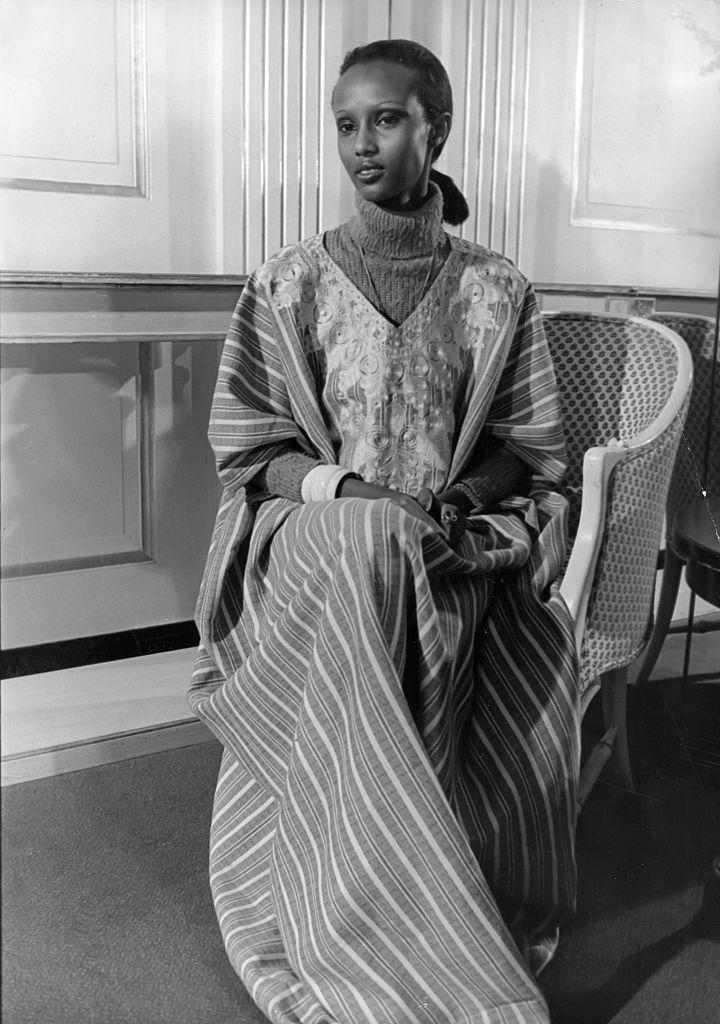 <p>The supermodel was born in Somalia and lived in both Saudi Arabia and Egypt thanks to her diplomat parents. She was studying political science when first approached by photographer Peter Beard in Nairobi. </p><p>Iman was instrumental in demanding equal pay for models of color within the industry. Photographed here in 1975 in New York City, Iman's effortless style is on display by pairing a turtleneck with a striped kaftan. </p>