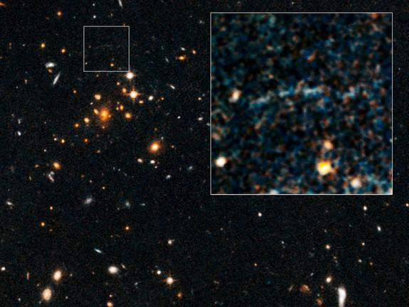 These images, taken by NASA's Hubble Space Telescope, show an arc of blue light behind an extremely massive cluster of galaxies, called IDCS J1426.5+3508, which is located 10 billion light-years away.
