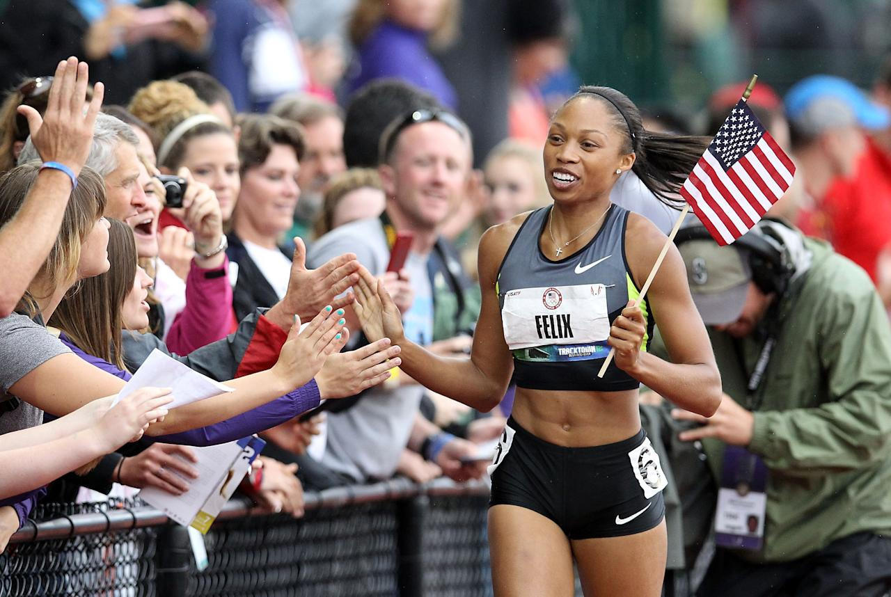 EUGENE, OR - JUNE 30:  Allyson Felix celebrates with fans on her victory lap after winning the Women's 200 Meter Dash Final on day nine of the U.S. Olympic Track & Field Team Trials at the Hayward Field on June 30, 2012 in Eugene, Oregon.  (Photo by Christian Petersen/Getty Images)
