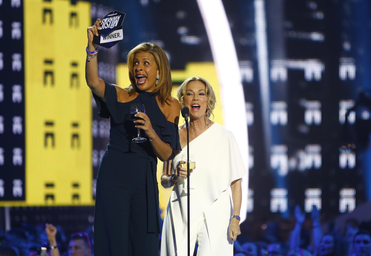 Hoda Kotb, left, and Kathie Lee Gifford hold wine glasses as they present the award for CMT performance of the year at the CMT Music Awards at Music City Center on Wednesday, June 7, 2017, in Nashville, Tenn. (Photo by Wade Payne/Invision/AP)