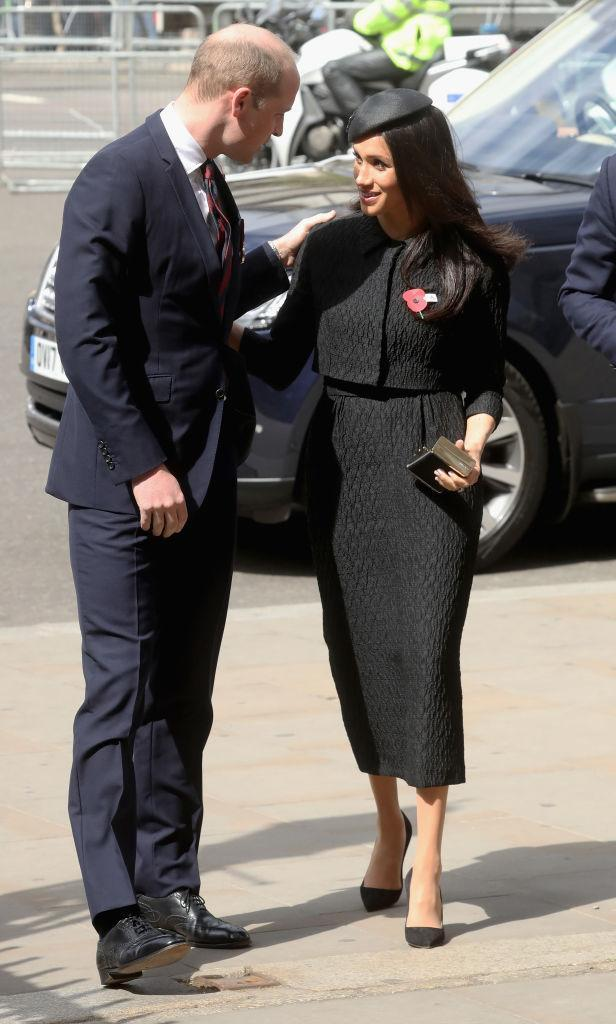 <p>On April 25 2018, Prince Harry and Meghan Markle joined Prince William at the Anzac Day service at Westminster Abbey.<br>For the second service of the day, Meghan Markle changed into an all-black look by Emilia Wickstead. She accessorised the outfit with a Philip Treacy hat. Could her look hint at her wedding dress designer? Stay tuned. <em>[Photo: Getty]</em> </p>