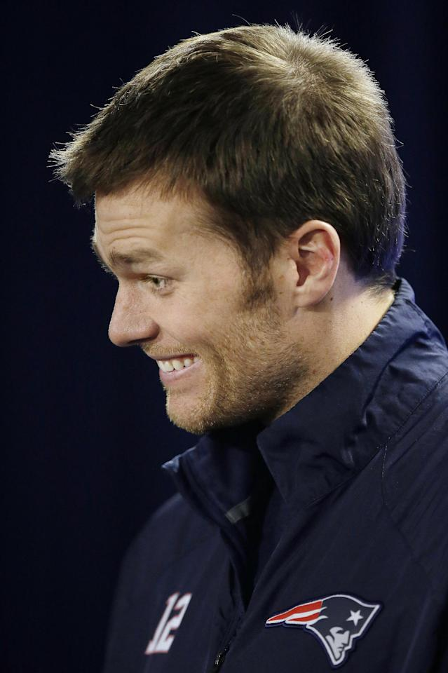 New England Patriots quarterback Tom Brady reacts to a reporter's question during an NFL football media availability at the team's training facility in Foxborough, Mass., Friday, Jan. 17, 2014. The Patriots are scheduled to play the Denver Broncos in the AFC championship game on Sunday in Denver. (AP Photo/Stephan Savoia)