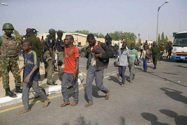 PHOTO: A group of schoolboys are escorted by Nigerian military and officials, Dec. 18, 2020, following their release after they were kidnapped last week in Katsina, Nigeria. (Sunday Alamba/AP)