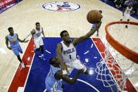 FILE - Philadelphia 76ers' Tony Wroten goes to the basket during an NBA basketball game against the Denver Nuggets in Philadelphia, in this Saturday, Dec. 5, 2015, file photo. Eighteen former NBA players, including Wroten, have been arrested on charges alleging they defrauded the league's health and welfare benefit plan out of about $4 million, according to an indictment Thursday, Oct. 7, 2021. (AP Photo/Matt Slocum, File)