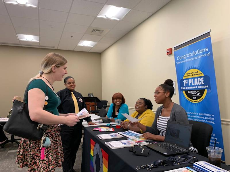 Blair Burns, left, speaks with representatives from Synchrony Financial at the trans job fair hosted by Charlotte Pride. Burns said that she has felt supported as a trans woman at her two current jobs, at Myers Park Country Club and at a fast-food restaurant, but wants to start looking for a full-time job with more room for career advancement.