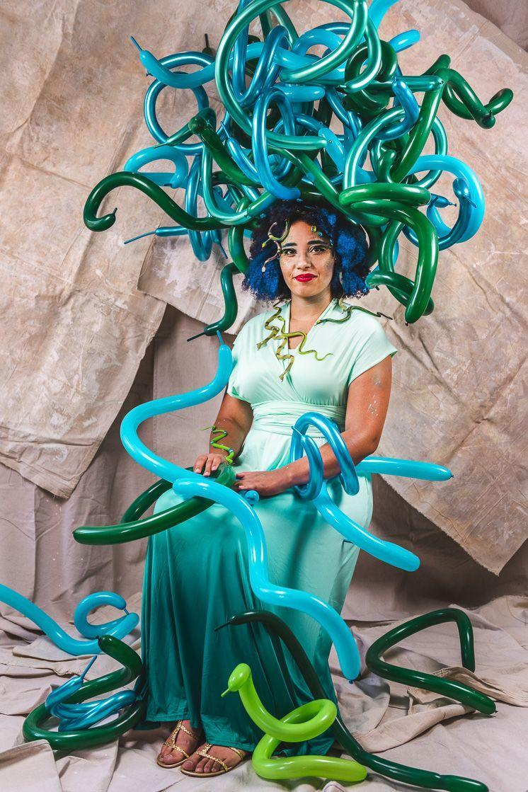 """<p>This clever take on Medusa, a monster from Greek mythology whose most marked characteristic is hair made of serpents, is created with <a href=""""https://thehousethatlarsbuilt.com/2017/05/how-to-curl-a-balloon.html/"""" rel=""""nofollow noopener"""" target=""""_blank"""" data-ylk=""""slk:curled balloons"""" class=""""link rapid-noclick-resp"""">curled balloons</a>, make up, and rubber snakes.</p><p><strong>Get the tutorial at <a href=""""https://thehousethatlarsbuilt.com/2020/10/diy-balloon-medusa-costume.html/"""" rel=""""nofollow noopener"""" target=""""_blank"""" data-ylk=""""slk:The House That Lars Built"""" class=""""link rapid-noclick-resp"""">The House That Lars Built</a>. </strong></p><p><a class=""""link rapid-noclick-resp"""" href=""""https://www.amazon.com/U-S-Toy-UST6097-Like-Snakes/dp/B00362QTP4/ref=sr_1_2?dchild=1&keywords=toy+snakes&qid=1624893239&sr=8-2&tag=syn-yahoo-20&ascsubtag=%5Bartid%7C10050.g.4571%5Bsrc%7Cyahoo-us"""" rel=""""nofollow noopener"""" target=""""_blank"""" data-ylk=""""slk:SHOP TOY SNAKES"""">SHOP TOY SNAKES</a></p>"""