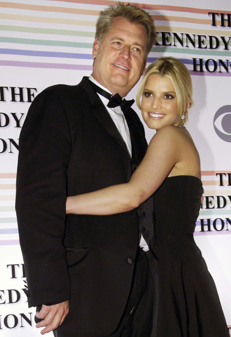 Singer Jessica Simpson (R) and her father Joe embrace as they arrive for the Kennedy Center Honors ceremony in Washington December 3, 2006. The 2006 honorees are composer Andrew Lloyd Webber, conductor Zubin Mehta, singer Dolly Parton, singer Smokey Robinson and film director Steven Spielberg. REUTERS/Jonathan Ernst (UNITED STATES)