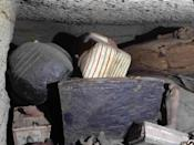 This Sept. 2020 photo provided by the Ministry of Tourism and Antiquities shows some of the antiquities that included more than two dozen ancient coffins and other artifacts, that were unearthed near the famed Step Pyramid of Djoser in Saqqara, south of Cairo, Egypt. The Tourism and Antiquities Ministry has said initial studied show that the newly found coffins had not been opened since they were buried more than 2,500 years ago. (Ministry of Tourism and Antiquities via AP)