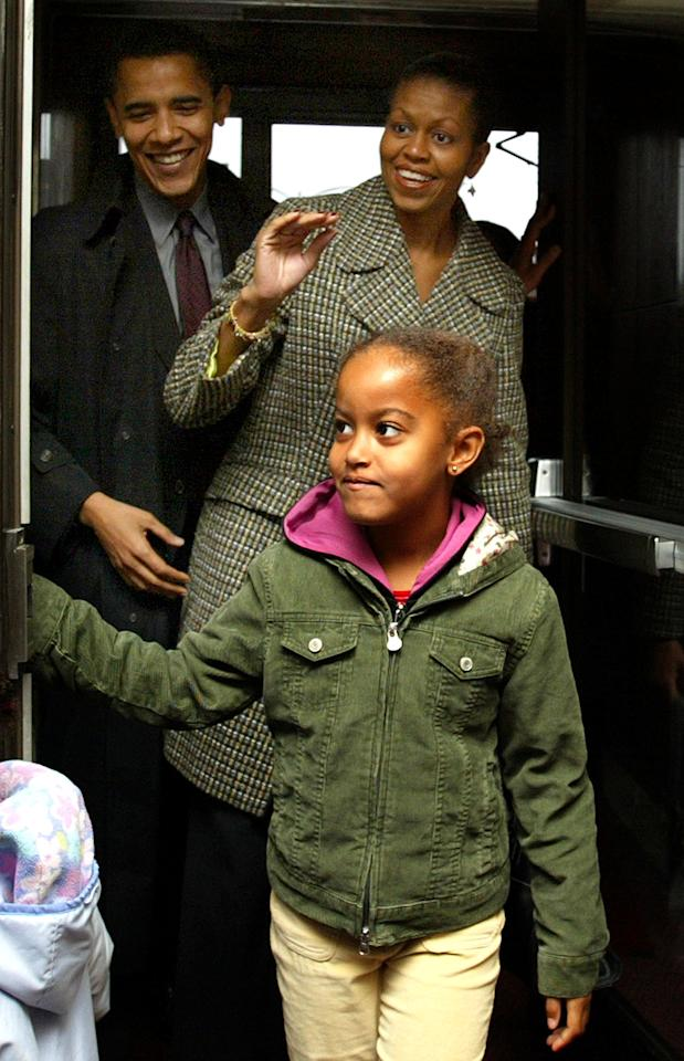 Illinois Democratic U.S. Senate candidate Barack Obama, left, arrives for the vote with his wife Michelle and his daughter Malia at Catholic Theological union polling place Tuesday, Nov. 2, 2004, in Chicago.(AP Photo/Nam Y. Huh)