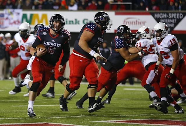 Northern Illinois quarterback Jordan Lynch (6) scores a touchdown against Ball State during the first half of an NCAA college football game Wednesday, Nov. 13, 2013, in DeKalb, Ill. (AP Photo/Jeff Haynes)