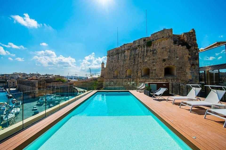 """<p>Perched opposite Valletta in Senglea – one of the island's historic Three Cities – the <a href=""""https://go.redirectingat.com?id=127X1599956&url=https%3A%2F%2Fwww.booking.com%2Fhotel%2Fmt%2Fcugo-gran-macina-grand-harbour-senglea.en-gb.html%3Faid%3D1922306%26label%3Dmalta-hotels&sref=https%3A%2F%2Fwww.goodhousekeeping.com%2Fuk%2Flifestyle%2Ftravel%2Fg37028393%2Fmalta-hotels%2F"""" rel=""""nofollow noopener"""" target=""""_blank"""" data-ylk=""""slk:Cugó Gran Macina"""" class=""""link rapid-noclick-resp"""">Cugó Gran Macina</a> is one of Malta's most prestigious hotels. </p><p>Its exterior fortress walls give way to an ultra-modern look inside, and the facilities are second to none, with a stylish pool and deck overlooking Valletta's iconic harbour, and an elegant bar and restaurant where the award-winning kitchen team conjure up sophisticated takes on traditional Maltese cuisine.</p><p><a class=""""link rapid-noclick-resp"""" href=""""https://go.redirectingat.com?id=127X1599956&url=https%3A%2F%2Fwww.booking.com%2Fhotel%2Fmt%2Fcugo-gran-macina-grand-harbour-senglea.en-gb.html%3Faid%3D1922306%26label%3Dmalta-hotels&sref=https%3A%2F%2Fwww.goodhousekeeping.com%2Fuk%2Flifestyle%2Ftravel%2Fg37028393%2Fmalta-hotels%2F"""" rel=""""nofollow noopener"""" target=""""_blank"""" data-ylk=""""slk:CHECK AVAILABILITY"""">CHECK AVAILABILITY</a></p>"""