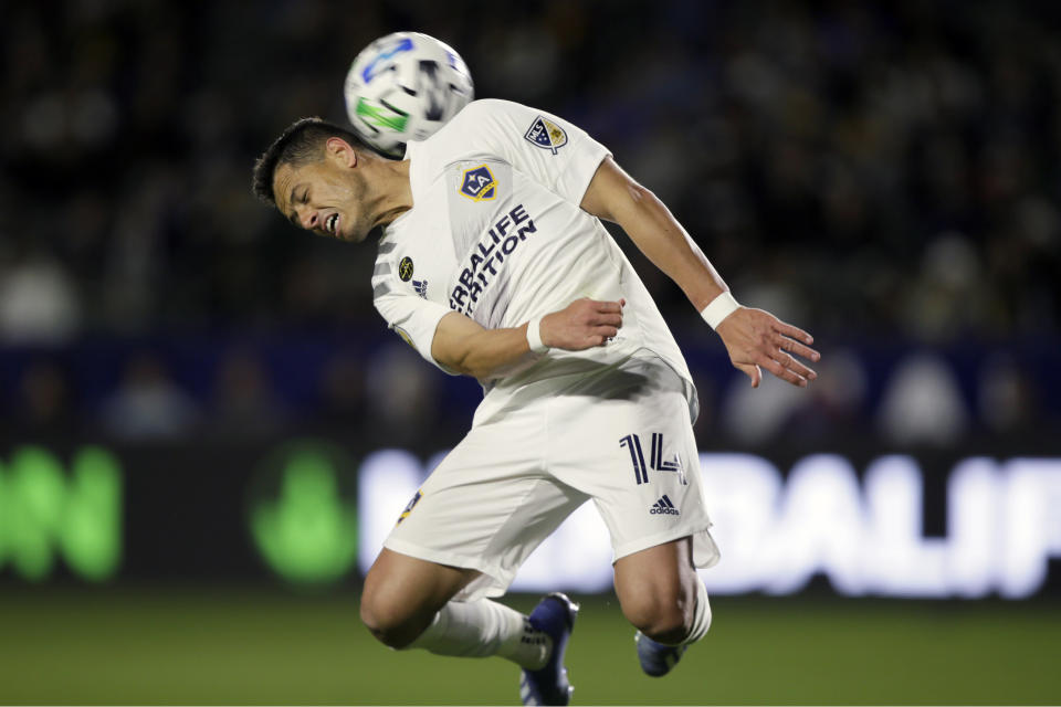 LA Galaxy forward Javier Hernandez heads the ball behind him during the second half of an MLS soccer match against the Vancouver Whitecaps in Carson, Calif., Saturday, March 7, 2020. (AP Photo/Alex Gallardo)