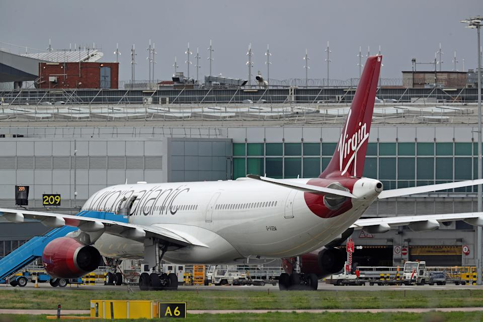 """A Virgin Atlantic plane taxiing at Heathrow Airport. The airline has admitted flying planes that are """"almost empty"""" in order to keep take-off and landing slots despite demand plummeting due to the coronavirus."""