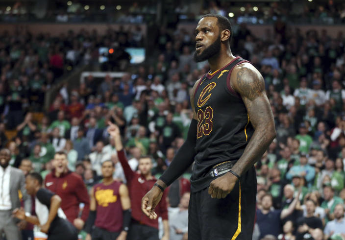 FILE - In this May 27, 2018 file photo, Cleveland Cavaliers forward LeBron James celebrates a basket against the Boston Celtics during the second half in Game 7 of the NBA basketball Eastern Conference finals, in Boston. President Donald Trump has unleashed a withering attack on James, deriding the intelligence of one of the nation's most prominent African-American men ahead of a rally in the NBA star's home state of Ohio. Trump blasted James after an interview with CNN anchor Don Lemon in which James deemed Trump a divisive figure. Meanwhile, the president's wife, first lady Melania Trump, has offered kind words for the NBA star and his work on behalf of children. (AP Photo/Elise Amendola, File)