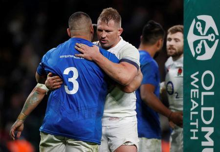 Rugby Union - Autumn Internationals - England vs Samoa - Twickenham Stadium, London, Britain - November 25, 2017 England's Dylan Hartley with Samoa's Donald Brighouse after the match Action Images via Reuters/Paul Childs