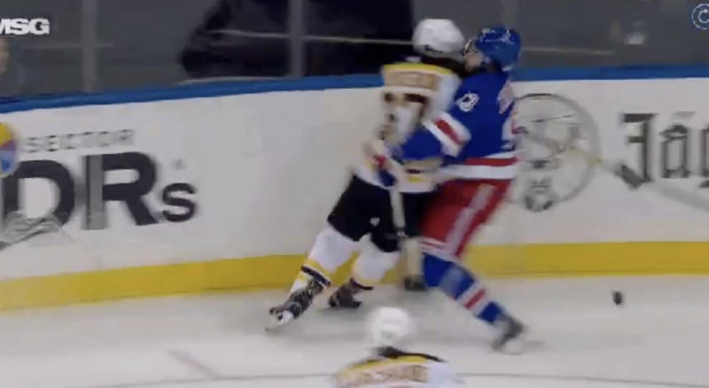 Rangers' Mika Zibanejad absorbs all of Bruins' Patrice Bergeron late in the first period on Sunday night. (Twitter//@HeresYourReplay)