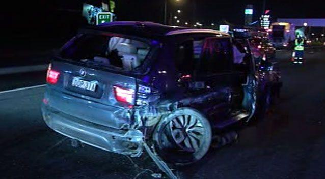 An allegedly stolen BMW crashed into a pole with nine people inside, on July 8. Picture: 7 News