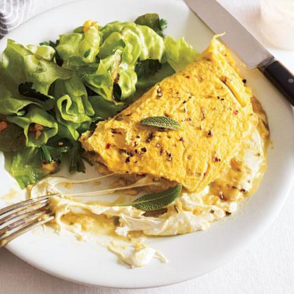 """<p>An omelet makes for a quick and easy dinner, but it doesn't have to be boring. <a href=""""https://www.myrecipes.com/t/cheese/mozzarella"""" rel=""""nofollow noopener"""" target=""""_blank"""" data-ylk=""""slk:Gooey mozzarella"""" class=""""link rapid-noclick-resp"""">Gooey mozzarella</a>, vibrant sage, and a generous hit of red pepper make this a standout dish.</p>"""