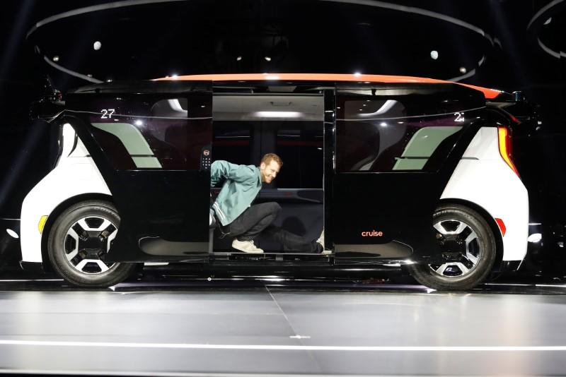 Cruise CTO Kyle Vogt stretches inside a Cruise Origin autonomous vehicle during its unveiling in San Francisco