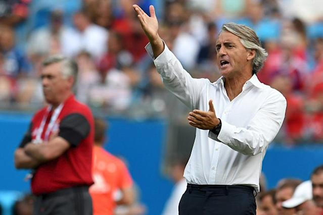 Former Inter Milan and Manchester City coach Roberto Mancini was given the daunting task of rebuilding Italy's national side on Monday following their astonishing failure to qualify for the World Cup.