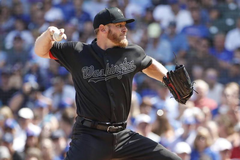 Washington Nationals starting pitcher Stephen Strasburg delivers against the Chicago Cubs during the second inning of a baseball game, Sunday, Aug. 25, 2019, in Chicago. (AP Photo/Kamil Krzaczynski)
