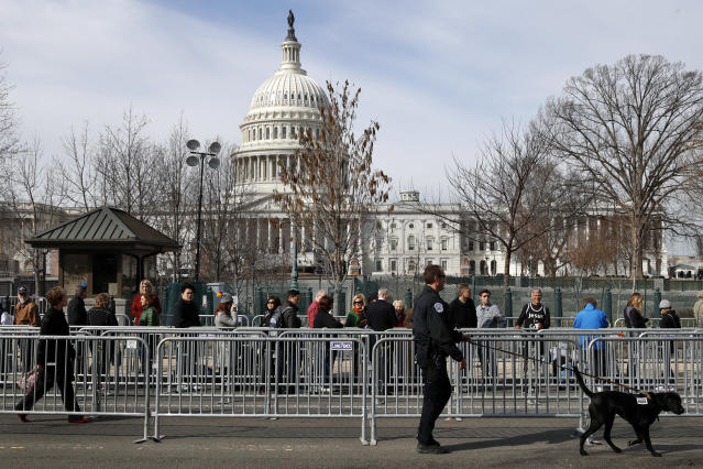<p>A Capitol Police K-9 unit works security as a line forms for the public viewing of the late Rev. Billy Graham at the Capitol, Wednesday, Feb. 28, 2018, in Washington. (Photo: Jacquelyn Martin/AP) </p>
