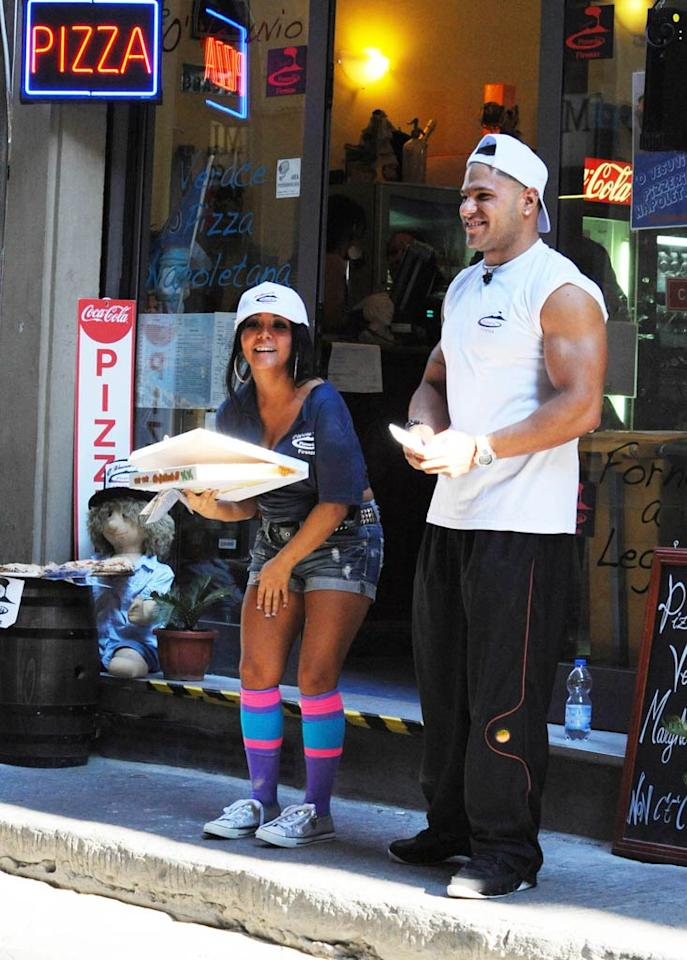 """Snooki -- in crazy, multi-colored knee socks -- and Ronnie were the lucky two put on pizza delivery duty! <a href=""""http://www.infdaily.com"""" target=""""new"""">INFDaily.com</a> - May 26, 2011"""