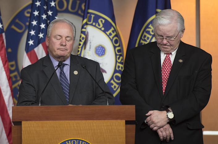 Rep. Joe Barton (R-Texas), right, coach of the Republican congressional baseball team, tells the story of the shooting that occurred during a baseball practice while he stands alongside Rep. Mike Doyle (D-Pa.), left, a coach of the Democratic congressional baseball team on June 14, 2017.