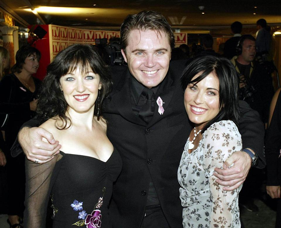 "LONDON - SEPTEMBER 4: British actors Kasey Ainsworth (L) ""Little Mo Slater"", Alex Ferns (C) ""Trevor Morgan"" and Jessie Wallace (R) ""Kat Slater"" from the program ""Eastenders"" attend the ""TV Quick Awards"" party at the Dorchester Hotel on September 4, 2000 in London. (Photo by Dave Hogan/Getty Images)"