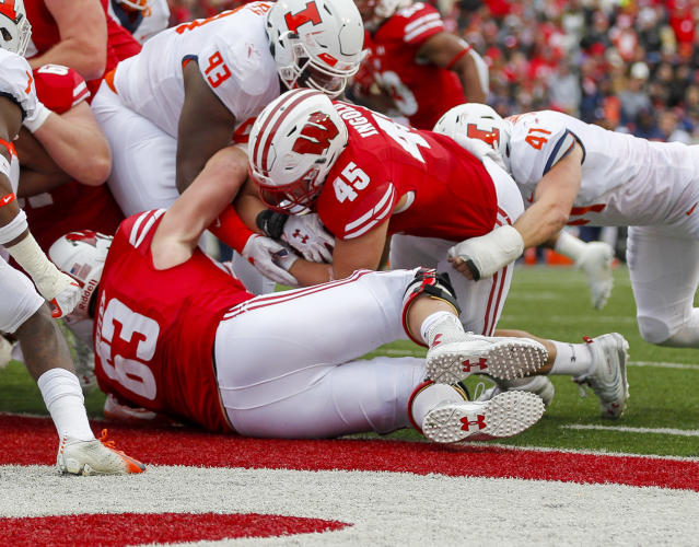 Wisconsin fullback Alec Ingold (45) scores against Illinois defensive lineman Calvin Avery (93) and linebacker Jimmy Marchese (41) during the first half of an NCAA college football game Saturday, Oct. 20, 2018, in Madison, Wis. (AP Photo/Andy Manis)