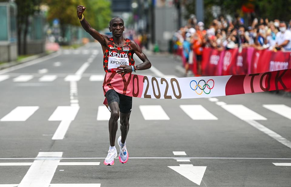 Hokkaido , Japan - 8 August 2021; Eliud Kipchoge of Kenya celebrates after winning the men's marathon at Sapporo Odori Park on day 16 during the 2020 Tokyo Summer Olympic Games in Sapporo, Japan. (Photo By Ramsey Cardy/Sportsfile via Getty Images)