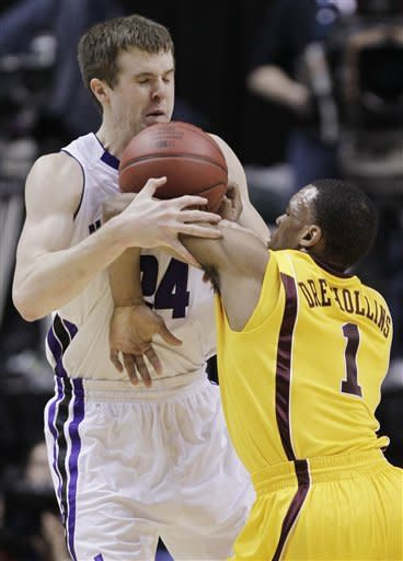 Northwestern forward John Shurna (24) and Minnesota guard Andre Hollins (1) battle for a loose ball in the first half of an NCAA college basketball game at the first round of the Big Ten Conference tournament in Indianapolis, Thursday, March 8, 2012. (AP Photo/Michael Conroy)