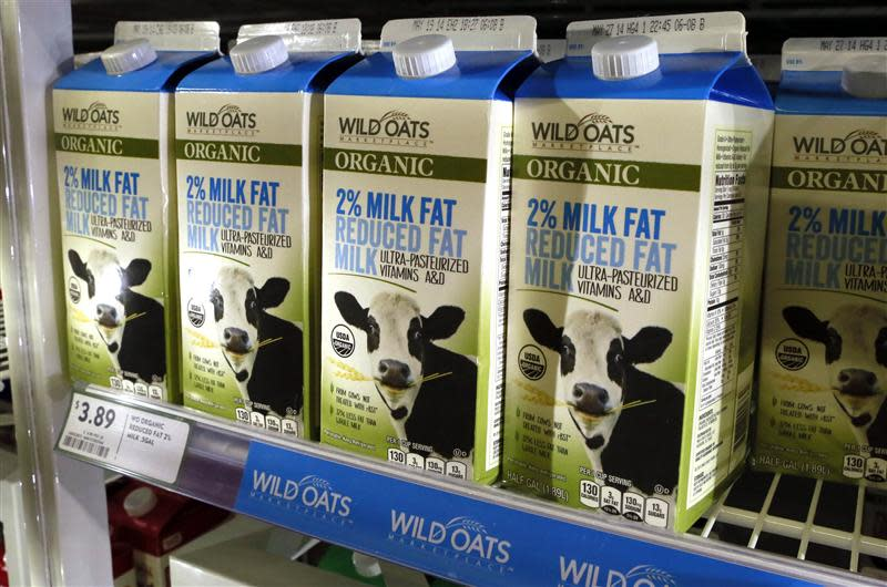 Cartons of milk produced by Wild Oats are seen in a Fresh & Easy store in Palm Springs, California April 9, 2014. Wal-Mart Stores Inc announced on April 10, 2014 that it had struck a deal to sell Wild Oats brand organic foods at non organic prices in its stores. The move could help revive Walmart flagging grocery sales and boost the profile of the resurrected Wild Oats brand. REUTERS/Sam Mircovich