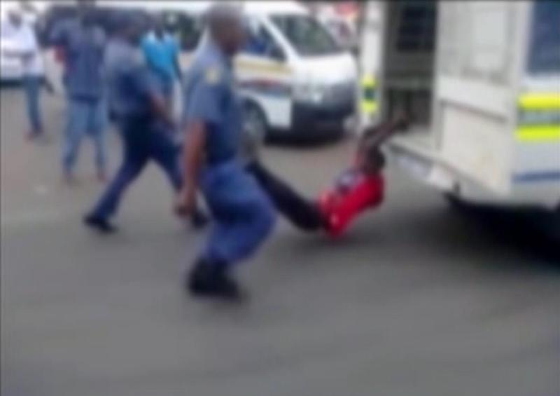 In this still frame from TV and courtesy of South African Daily Sun newspaper, showing a South African man with his hands tethered to the back of a police vehicle being dragged behind as police hold his legs up and the vehicle apparently drives off, east of Johannesburg Tuesday Feb. 26, 2013. The man died of his injuries.  In video filmed on a mobile phone, uniformed police are seen trying to subdue the man, then tethering him to the back of a police vehicle which drives off, watched by a large crowd.  Moses Dlamini of the Independent Police Investigative Directorate said early Thursday Feb. 28 2013 on ENCA TV network that his service has opened a murder probe. (AP Photo/The Daily Sun) TV OUT