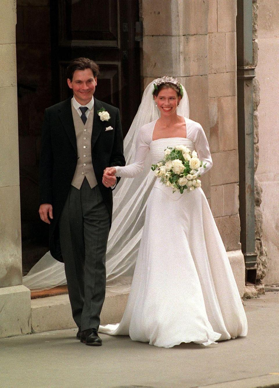 <p>Lady Sarah Armstrong Jones, Princess Margaret's daughter, donned a simple, feminine dress designed by British designer Jasper Conran. Conran's website notes that the dress was made of silk crepe chiffon with an underskirt of light and heavy satin organza layers, layered in silk crepe.</p>
