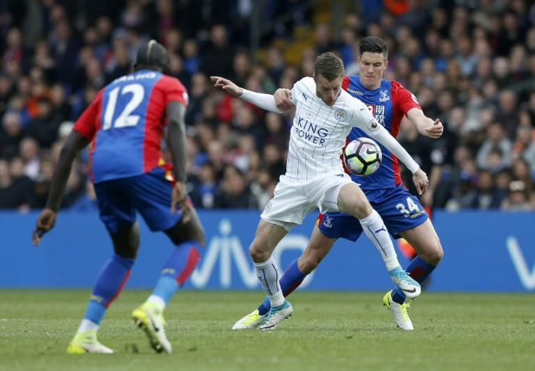 Leicester City's Jamie Vardy (C) vies with Crystal Palace's Martin Kelly (R) and Mamadou Sakho during their match at Selhurst Park in south London on April 15, 2017