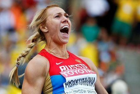FILE PHOTO - Maria Abakumova of Russia reacts as she competes in the women's javelin throw final during the IAAF World Athletics Championships at the Luzhniki stadium in Moscow August 18, 2013. REUTERS/Dominic Ebenbichler/File Photo