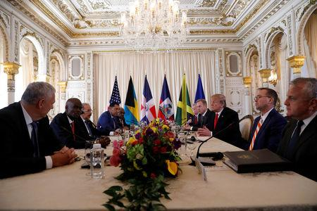 U.S. President Donald Trump takes part in a working visit with Saint Lucia Prime Minister Allen Chastanet, Haiti's President Jovenel Moise, Jamaica's Prime Minister Andrew Holness, Bahamas Prime Minister Hubert Minnis, White House national security adviser John Bolton, Acting U.S. Defense Secretary Patrick Shanahan, Acting White House Chief of Staff Mick Mulvaney and U.S. Deputy Secretary of State John J. Sullivan at Mar-a-Lago in Palm Beach, Florida, U.S., March 22, 2019. REUTERS/Kevin Lamarque