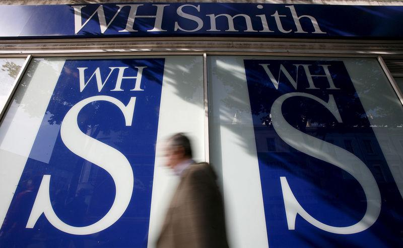 File photo of pedestrians walking past a WH Smith shop in London