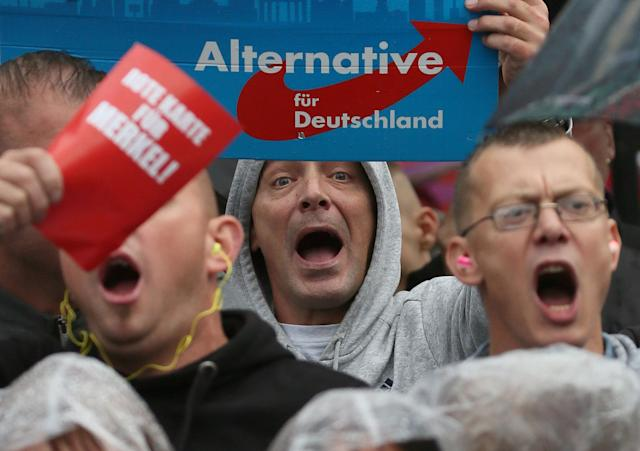 Supporters of the hard-right Alternative for Germany (AfD) party shout slogans during an election campaign rally of German Chancellor Angela Merkel.
