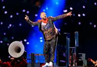 """<p>Timberlake wore a nature-inspired suit with a neckerchief.</p><p><a class=""""link rapid-noclick-resp"""" href=""""https://www.youtube.com/watch?v=v6xUgawDQB0&ab_channel=justintimberlakeVEVO"""" rel=""""nofollow noopener"""" target=""""_blank"""" data-ylk=""""slk:WATCH NOW"""">WATCH NOW</a></p>"""