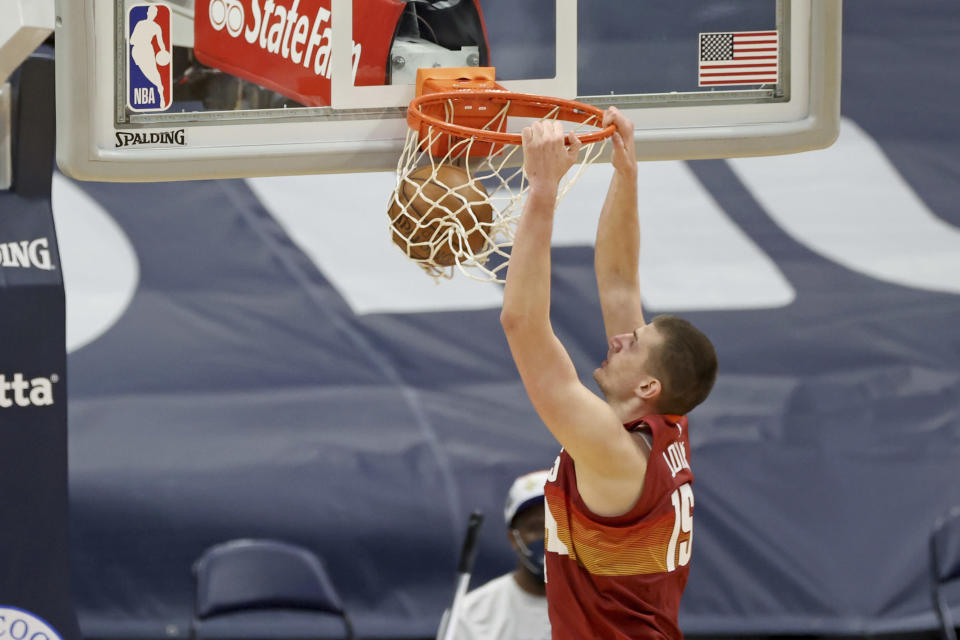 Denver Nuggets center Nikola Jokic dunks during the second half of the team's NBA basketball game against the New Orleans Pelicans in New Orleans, Friday, March 26, 2021. (AP Photo/Rusty Costanza)